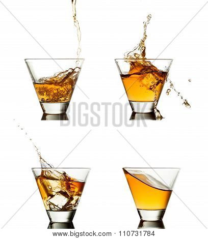 splash of whiskey with ice isolated on white