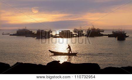 traditional asian fishing at sunset