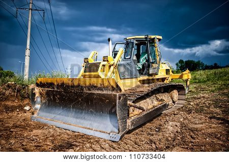 Industrial Backhoe, Bulldozer Moving Earh And Sand In Sandpit Or quarry