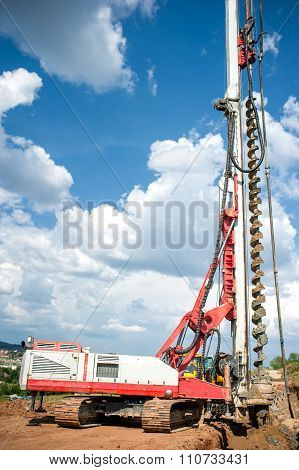 Industrial Construction Site With Drilling Rig Making Holes In The ground
