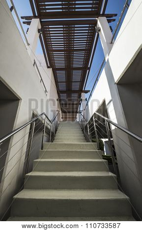 A stairway of multistory outdoor car park.