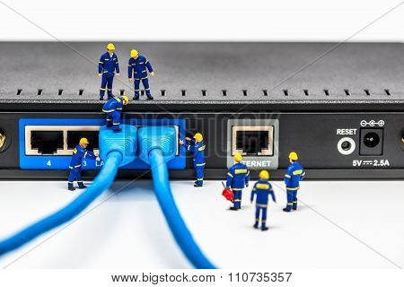 Group Of Engineers Connecting Fiber Network Cables