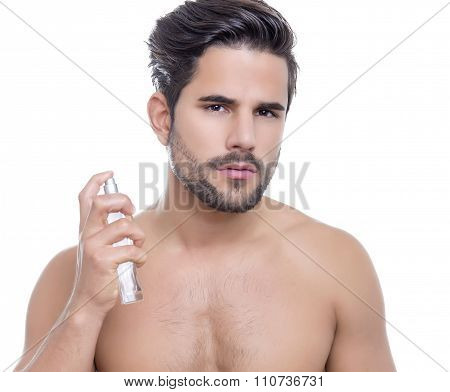 handsome young man performing morning routine