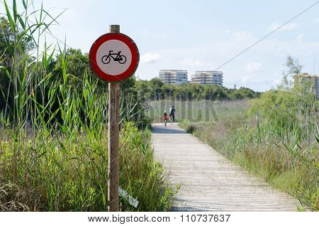 No trespassing sign with bicycles