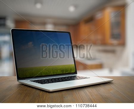 laptop on old wooden table in the kitchen