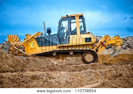 Bulldozer Or Excavator Working With Soil On Construction Site Of building road