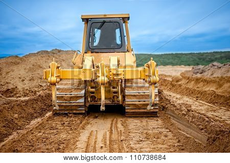 Bulldozer With Steel Blade Moving Soil And Sand Around And Working in  sandpit