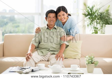Mature man and his doctor at home