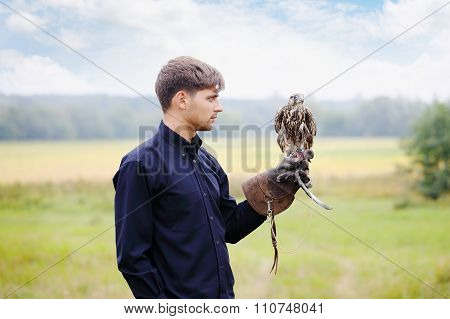 Young  man falcon feeds