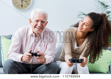Senior Playing On The Console