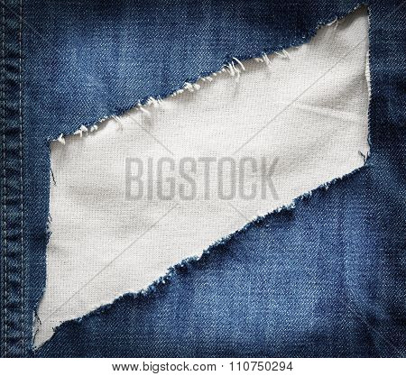 White fabric texture with torn blue jeans