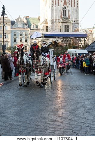 CRACOW POLAND - DECEMBER 6 2015: the parade of Santa Clauses on motorcycles around the Main Market Square in Cracow. Poland