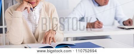 Senior Student With Exercise Book