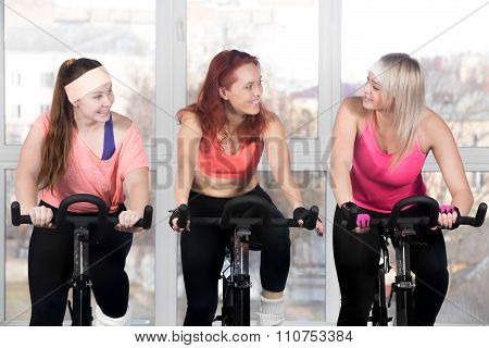Three Women Cycling In Class
