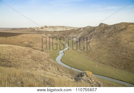 Small river and hills in prairie