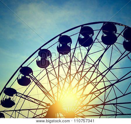 Ferris Wheel On The Sunset