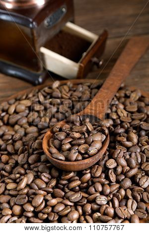Grinder And Coffee Beans With A Wooden Spoon
