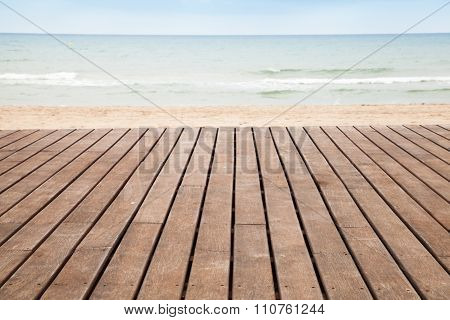 Sea, Sand And Wooden Pier Perspective