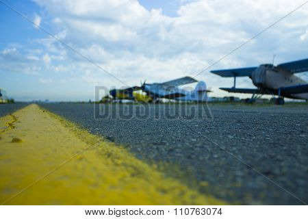 small aircraft at the airport runway is not in focus
