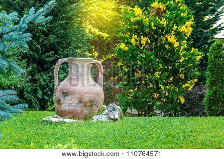 Ancient Amphora In Garden