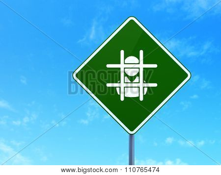 Law concept: Criminal Freed on road sign background