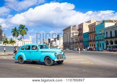HAVANA,CUBA - NOVEMBER 24,2015 : Street scene with old american car in downtown Havana