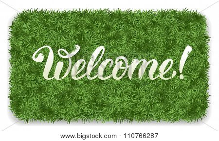 Welcome. Doormat of the green grass with calligraphic inscription Welcome. Isolated on white background. Vector illustration.