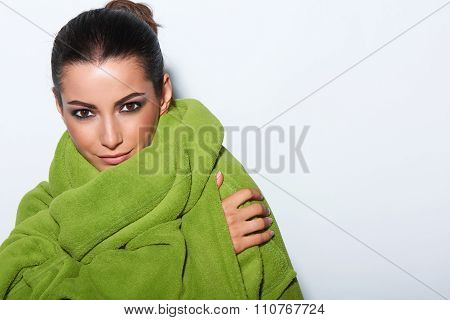 Woman with smokey makeup and green turban