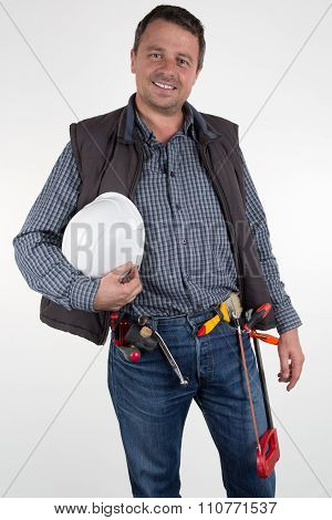 Happy And Smiling Worker With Tools On His Belt - Isolated