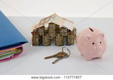 Piggy Bank Style Money Box, Folders With Key Isolated On A White