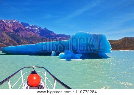 Ice and sun Patagonia. Excursion on the tourist boat on Lake Viedma.  White-blue huge icebergs float near a ship board