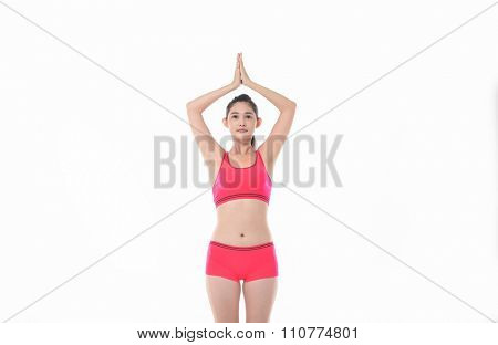 Young girl doing yoga exercises isolated on white background