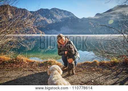 Woman And Dog At Lake Offensee On A Sunny Winter Day