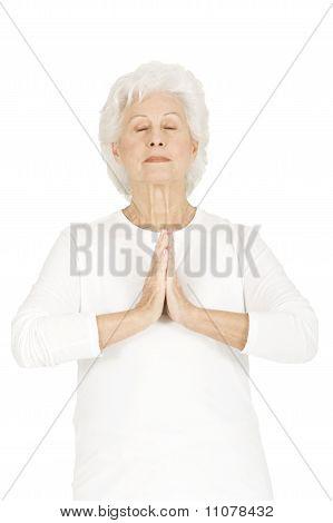 elderly woman practicing yoga