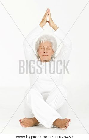 elderly woman practicing yoga