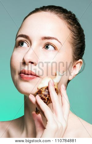 Woman with snail on her cheek.