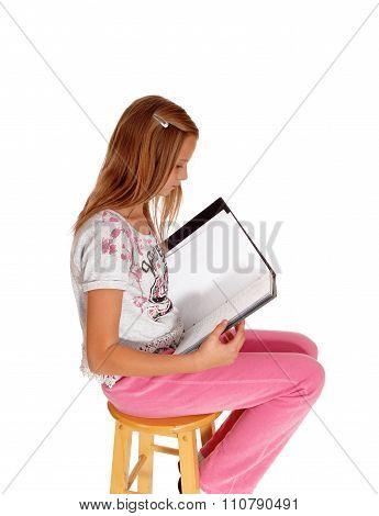 Schoolgirl Writing In Her Schoolbook.