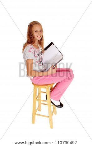 Schoolgirl Sitting With Her Schoolbook.