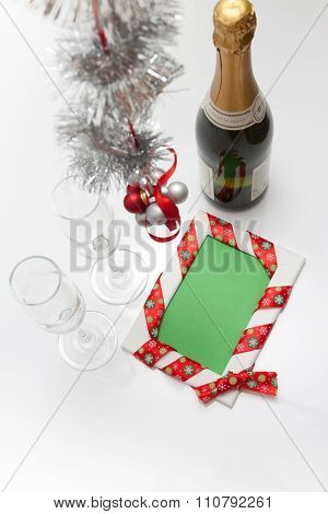 Greeting Card Template Made Of Two Glasses And Bottle Of Champagne With Balls Hanging On Ribbon, Tin