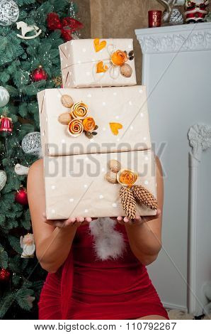Christmas Interior. Girl Holds Boxes