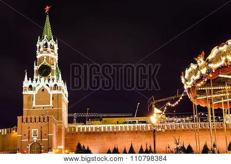 Spasskaya Tower Of Kremlin And Merry-go-round
