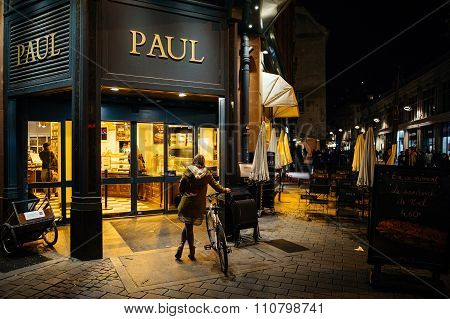Paul Boulangerie Et Patisserie With Customer Waiting On Bike