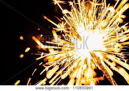 Bright Christmas Sparkler Closeup On A Black Background, Soft Focus