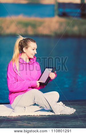 Girl Learning Yoga From Tablet.