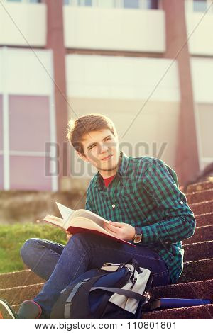 University young student man holding a book