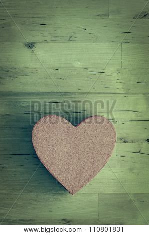 Pink Heart Shaped Box On Wood Plank Table - Cross Processed