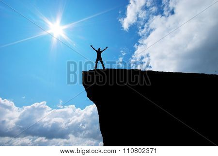 Man on the mountain edge. Conceptual scene.