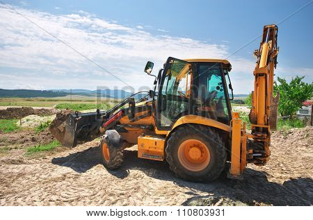 Excavator working on the ground. Building design.