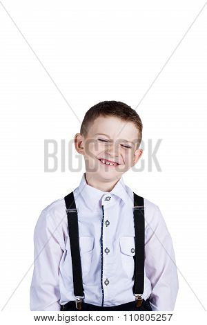 Smiling little boy holding wearing costume with braces