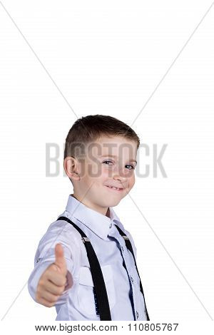Little boy with thumb up gesture isolated over grey